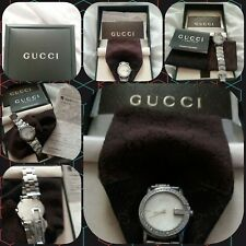 Ladies Gucci diamond watch genuine been in original box for 10 years .
