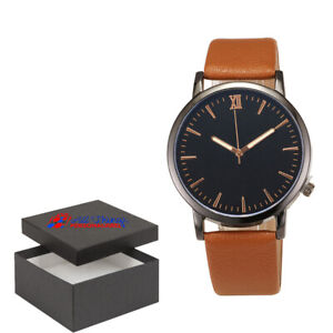 Watch Brown Leather Watch With a Black and Gold Face