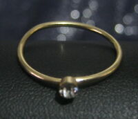 Great simple gold tone metal ring with small white stone size P