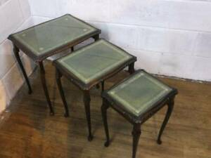 SET of DARK MAHOGANY GREEN LEATHER GLASS TOPPED NEST OF 3 TABLES.
