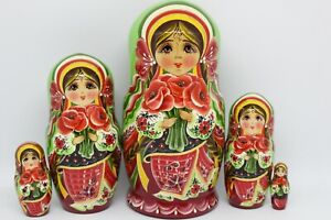 "Nesting dolls, matryoshka (7""tall ,5 pieces inside) Ukrainian girl with flowers"