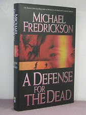 1st, signed by author, A Defense for the Dead by Michael Fredrickson (2004)