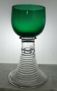 Antique roemer drinking glass on cone formed stem.