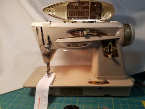 SINGER 503A sewing machine, Slant-o matic with case and accessories. Vintage