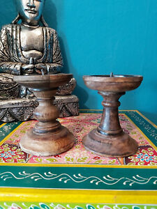 A PAIR OF CHUNKY INDIAN DARK WOOD CANDLESTICKS