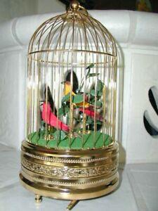 MMM Spieluhr, vergoldet, mit drei singenden Vögeln im Käfig