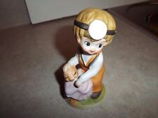 Young Child Appears to be Playing Doctor with Animal Figure Figurine