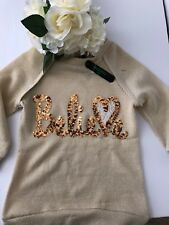 girls sweaters NWT Vibrant Gold Color. Gold Sequence Spells Out BELIEVE.