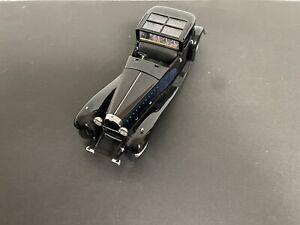 Collectible vintage car. The 1930 Bugatti Royale Coupé Napoléon. Black color.