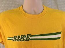Vtg 80s NIKE T-Shirt Yellow SMALL (tag reads medium) Silver Tag Spellout Retro