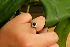 18ct white gold sapphire and diamond cluster in raised rex crown style  M  2.5g