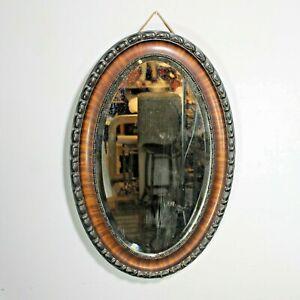 Bevelled oval wall mirror vintage antique ebonised frame tiger wood overmantle