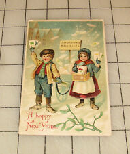A Happy New Year Children Selling Cards Vintage 1907 Embossed Postcard