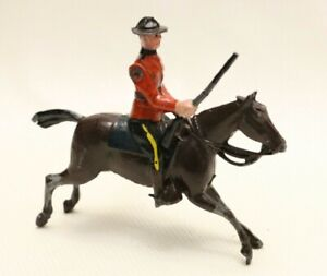 BRITAINS LTD HORSEMAN FIGURINE WITH MOVEABLE ARM MADE IN ENGLAND