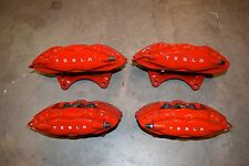 tesla Model S Red brembo brake caliper.