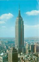 New York City New York~Empire State Building~A Few Puffy Clouds~1950s-1970s