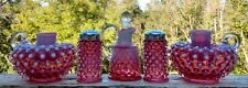 Fenton glass hobnail cranberry opalescent cruet, candle holders, shakers