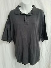 Greg Norman polo. Men's size XL. grey shirt. short sleeve top.