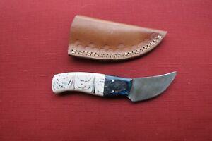 Ladies Damascus caping knife with pink swirl ceramic handle, leather sheath