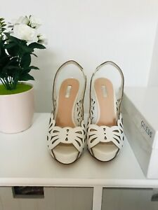guess sandals size 5, white, high heels, platform. Leather, good condition