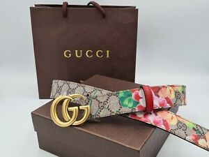 Gucci belt with floral print and golden tone buckle