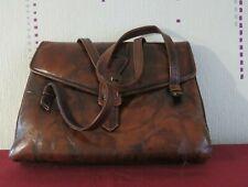 sac à main vintage en cuir de couleur brun