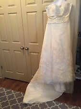 wedding dress size 12 champagne color Casablanca brand. Professionally cleaned