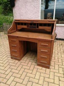 A 1920's blond oak roll top desk / bureau