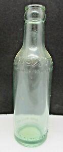 Greenish Glass Moxie Bottle