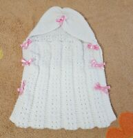 Hand Knitted baby Swaddle, Sleeping bag, Carry Cot with a ribbon bow finish