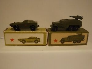 TWO RUSSIAN MILITARY VEHICLES..AN ARMOURED CAR AND A MULTI ROCKET LAUNCHER BOXED