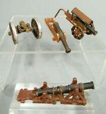 Lot of 4 miniature mixed metals canons one mounted on wood ca. 20th c.