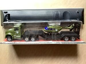1.64 DIE-CAST TRAILER WITH HELICOPTER– NEW Tesco