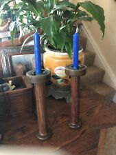 Two antique wooden thread spool candle sticks with blue candles