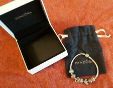 Genuine Pandora Sterling Silver charm bracelet plus 5 Genuine charms - Boxed