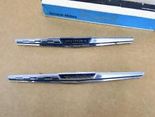 NOS PONTIAC 1966 VENTURA REAR QUARTER EMBLEMS PAIR        1