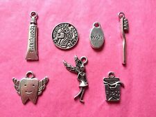 Tibetan Silver Tooth Fairy Mix pack of charms 7 per pack