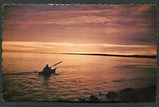 Posted 1971. View of a Man Paddling a Kayak in the Arctic Sea, Canada