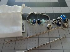 Authentic new Trollbeads bracelet with 4 beads and sterling stopper,other extras