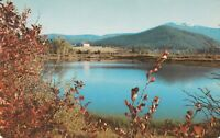 A)  Coeur d' Alene Valley, ID - Distant View of Cataldo Mission Beyond Lake