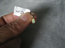 Ethiopian Opal oval pendant, 0.31 carats, set in 0.31 grams of 9K Yellow Gold