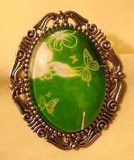Festooned Silvertone Green & White Butterflies in Flight Glass Cameo Brooch Pin