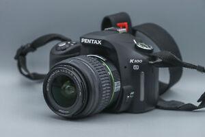 PENTAX K100D SR + SMC Pentax-DA 1: 3,5-5,6 18-55mm AL, Tested