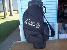 A King Cobra Tour Cart Bag. Black, Made By Burton. White And Yellow Letters.