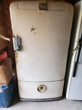 frigidaire refrigerator beige in color and is a antique