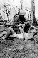 WWII photo American Marine with a flask in a Japanese wounded captive 1337