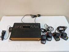 Atari 2600 Woodgrain Console  with 4 Games and Controllers