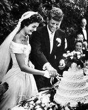 JOHN F. KENNEDY AND NEW WIFE JACQUELINE CUT WEDDING CAKE - 8X10 PHOTO (AA-796)