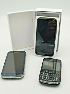 Three Black Cell Phones Moto X and Motorola and Blackberry Curve U.S. Cellular