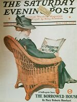 1909 Saturday evening Post cover woman hat red wicker chair